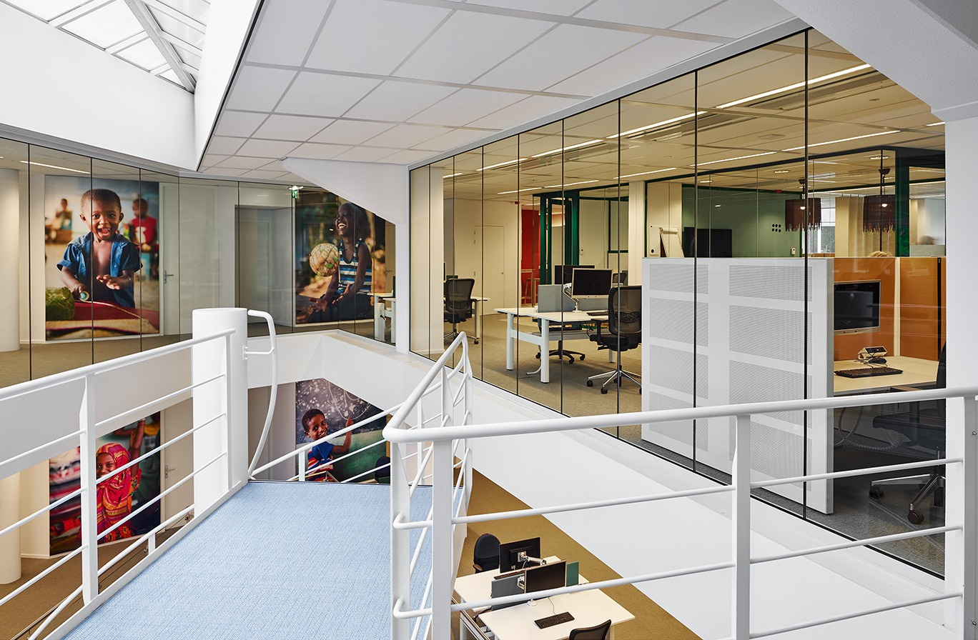 Fall through safe full glass fire resistant glass EI60 wall and at UNICEF in The Hague, The Netherlands.