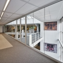 Fire protecting glass wall with sliding doors
