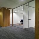 Single glass wall, wooden door and a glass door