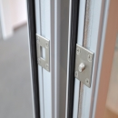 Safety pin on the hing side of a fire resistant framed door EW30