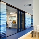 Glass partition wall with 1½ double doors