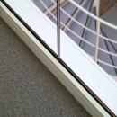 Floor rail and join of a fire resistant glass wall