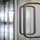 300 mm U-shaded door handle on a glass sliding door