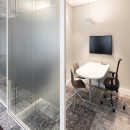 Room for private conversation made of double glass with acoustic foil