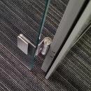 Detail of a stainless steel hinge in the DK42 door frame