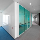 IQ-Cristal partition wall with blue colored glass an shades between the glass