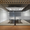 Single glass office wall with design foil added