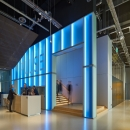 Blue light behind the IQ-Single glass wall at Pulse Delft