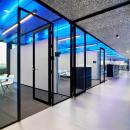 Corridor with glass partition and fire resistant doors at The Flow Houthavens Amsterdam
