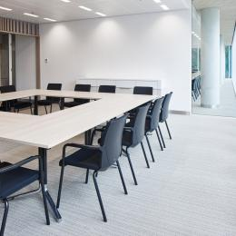 Meeting room with high acoustic glass partition.