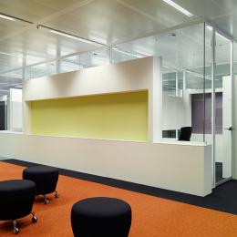 Glass office walls with integrated cabinets