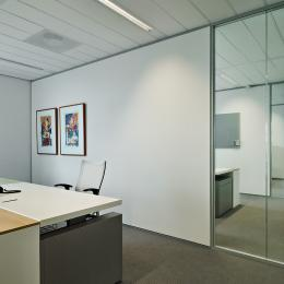 Office divided walls are partial made of double glass and closed wall.