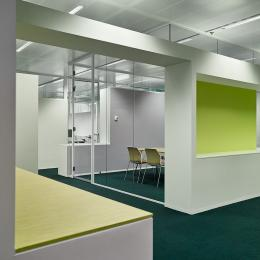 Glass office walls combined with cabinets