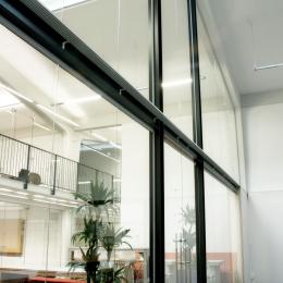 Extra high arc shape glass wall with steel construction and double doors