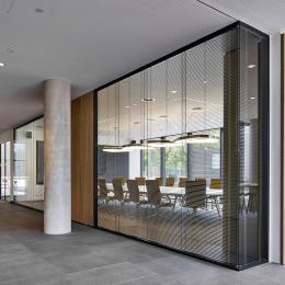 Double glass partition wall with blinds between the glass