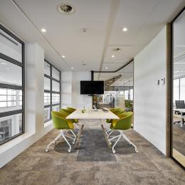 Conversation room with glass partition wall and closed elements