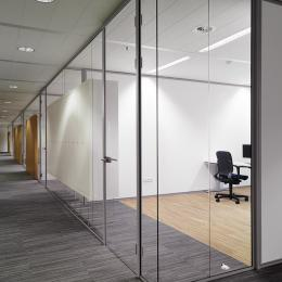 Glass wall with integrated cabinets