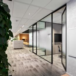Glass partitions with framed doors
