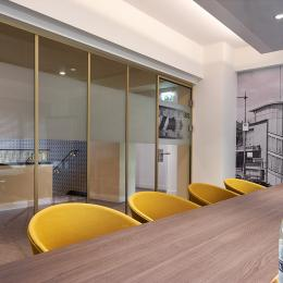 Meeting room with industrial look glass wall in gold colored frame