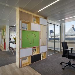 Circular office wall made of reused materials.