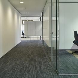 Office wall made of single glass with acoustic foil in between