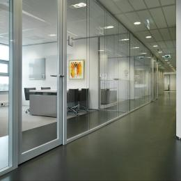 Corridor with double glass partition wall and framed doors