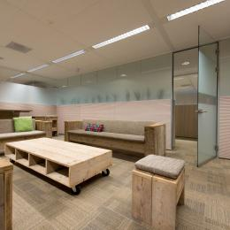 Partitions wall of acoustic laminated glass with wood panels and privacy film added