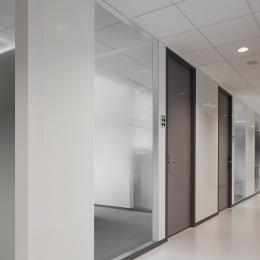 Corridor partition with steel panels and doors combined with glass panels