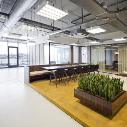 Large open space divided in smaller offices with glass demountable walls.