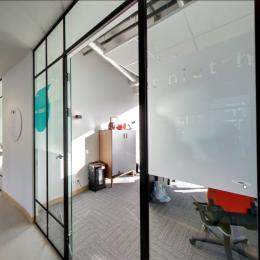 Classic Van Nelle style glass wall with black mullions