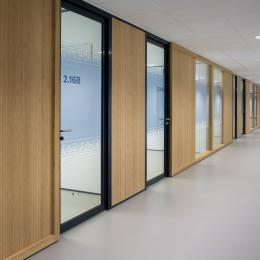 Corridor with closed partition and aluminum frames doors
