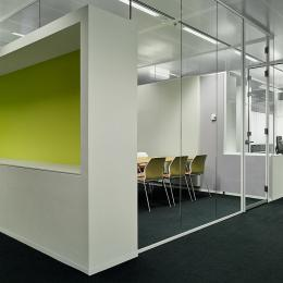 Full glass office walls combined with cabinets