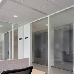 Glass and steel panels combined in a partition