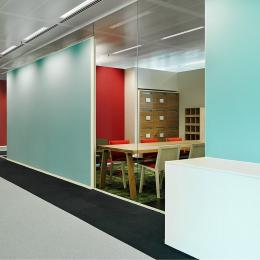 Single glass office wall with acoustic panels attached to the glass