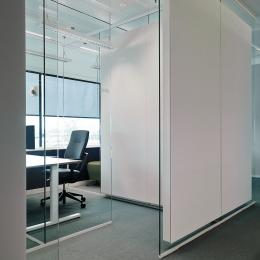 Acoustic panels glued ont a glass wall to absorb the sound