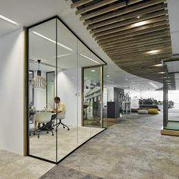 Single glass partitions wall combined with wooden door frames