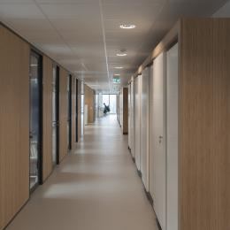Corridor with closed partition and aluminum framed doors