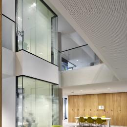 Single glass office walls at staircase