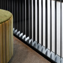 A close up of a partition wall with blinds inside