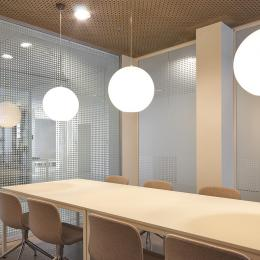 Conversation room with single glass system wall with dotted print.
