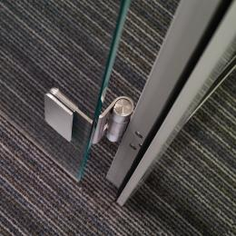 Detail of a stainless steel hinge in the DK42 door frame