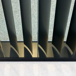 A close up of a profile with blinds inside