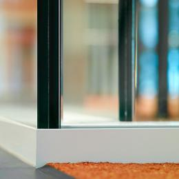 Detail of double glass partition wall 90 degrees corner