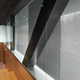 Two single glass partition walls around the building construction