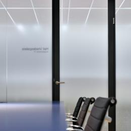 Office with glass partition with sandblast foil