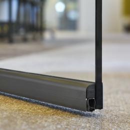 Glass door with dropseal to reduce sound under the door