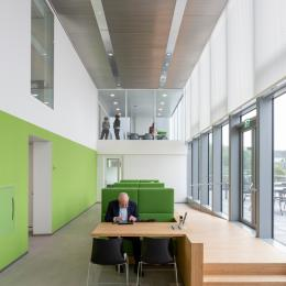 Central workspace with QbiQ Glass partition on the first floor