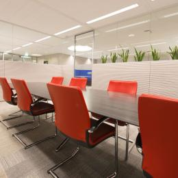 Conference room with single glass wall and wood panels