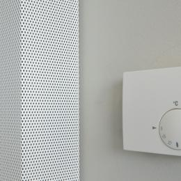 Acoustic panel adde to a wall