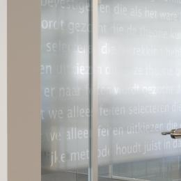 IQ-Single glass wall with tampered glass door an text design foil added